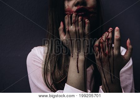 Zombie women death ghost standing with blood darkness background horror halloween festival concept