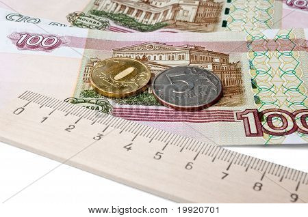 Coins, Banknotes And A Ruler - The Concept Of The Ruble  Rate