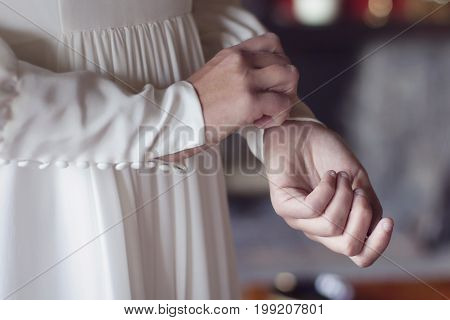 A bride getting dressed in her wedding day