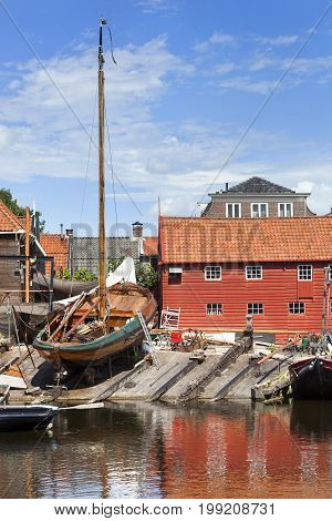 Historic shipyard with wooden fishing boat in the harbor of the village Spakenburg in the Netherlands.