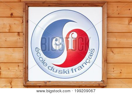 Meaudre, France - June 23 2017: French ski school logo on a wall called ecole de ski francais or ESF in french. ESF Is a consortium of 250 French ski schools with 17,000 instructors