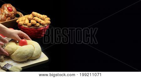 Easter bread preparation on black background - copy space