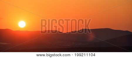 Sunset over mountain silhouettes