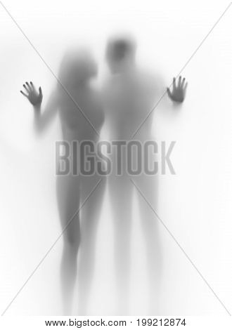 Lover couple body silhouette and hands touching a glass surface
