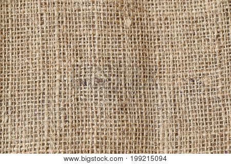 Close up of natural burlap hessian sacking for background.