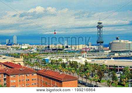 Aerial view of Barcelona. La Barceloneta Port Vell sea and red cabin of the cableway. Catalonia Spain.