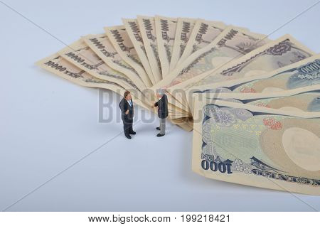 Tiny Person Standing On A Huge Of Money