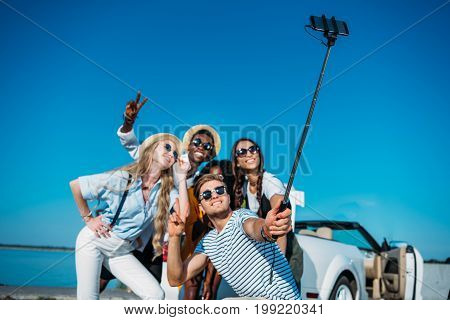 Multiethnic Happy Friends Taking Selfie Together On Smartphone