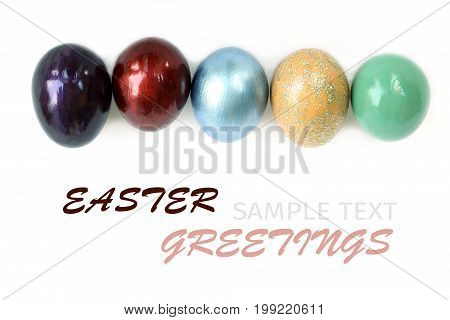Colorful easter eggs on white background with sample text.