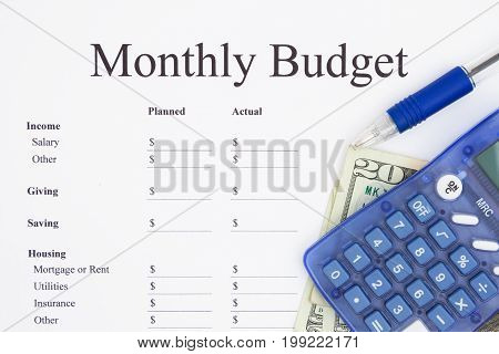 Creating a monthly budget A print out of a monthly budget with pen and calculator