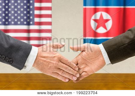 Representatives of the USA and North Korea shake hands