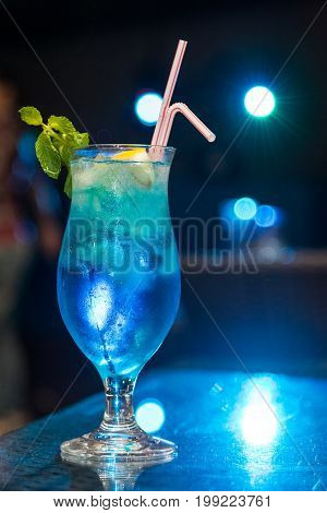 Cool blue cocktail on a blurry background