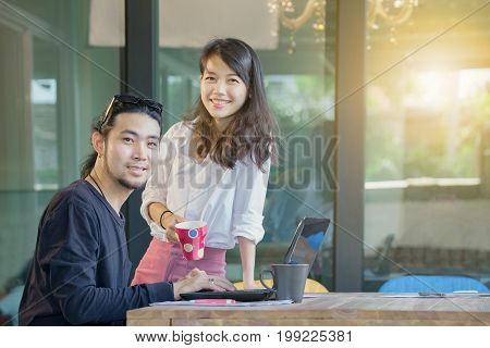 asian younger freelance man and woman happiness emotion working at home