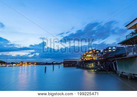 Riverside community at Chao Phraya River Bangkok Thailand at evening.