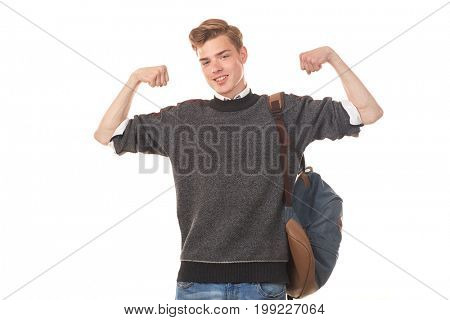 Portrait of skinny college boy showing biceps against white background