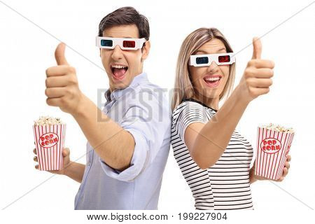Young man and a young woman with 3D glasses and popcorn holding their thumbs up isolated on white background