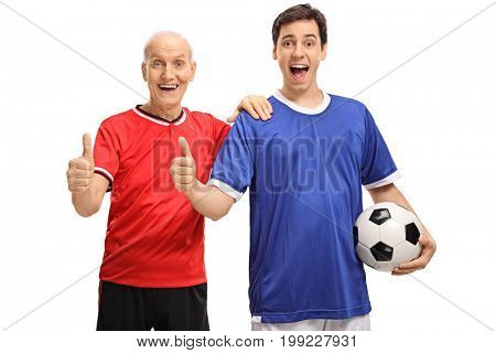 Senior and young man dressed in jerseys holding a football and making thumb up signs isolated on white background