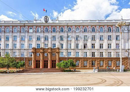 Academy of science of republic of moldova office building, stefan cel mare street in the chisinau downtown, blue sky and clouds