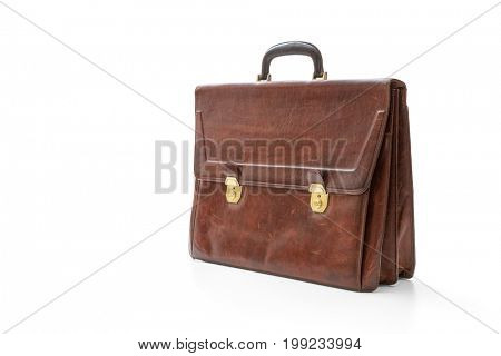 Brown leather briefcase with brass buckle on white, included clipping path