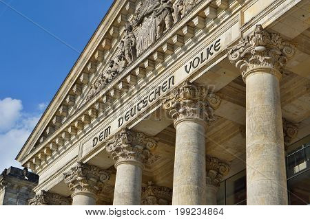 Architectural detail of the top of the German parliament (Reichstag - Bundestag) in Berlin with decorated columns and symbolic triangle