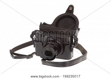 Digital compact camera with black leather case isolated on white
