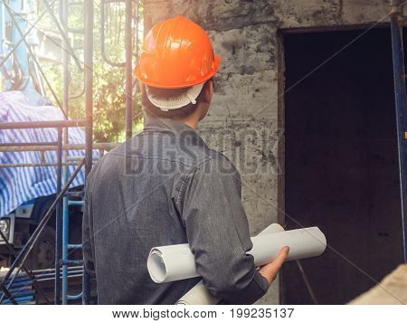 Foreman or foreman with blueprint on construction site