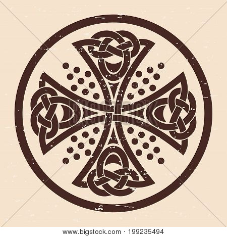 Celtic cross. National ornament on a beige background with the aging effect.