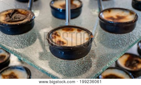 Turkish traditional dairy style rice pudding sutlac served in a crock on wood background