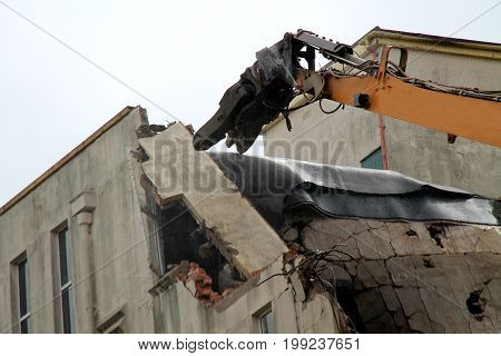 The Head of a Demolition Grab Working on a Building.