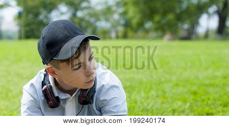 Pensive Young man with headphones listening to music