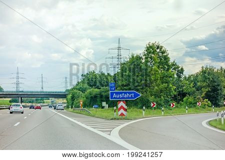Pleideslheim Germany - June 28 2017: Highway exit (Ausfahrt) german motorway Autobahn A81 near town Pleidelsheim direction to Stuttgart / Ludwigsburg city