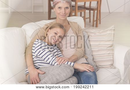Mother After Chemotherapy Hugging Daughter