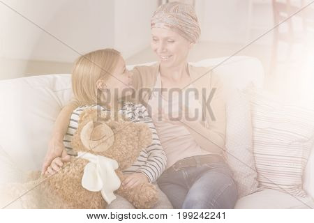 Girl Talking With Ill Mother