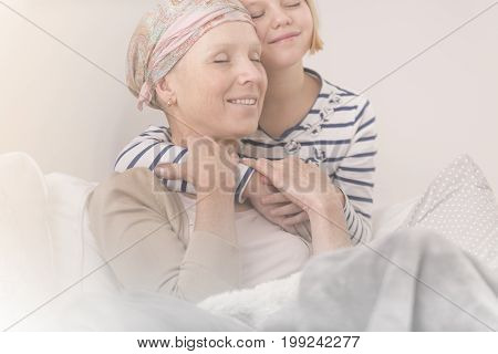Child Embracing Mother With Leukemia