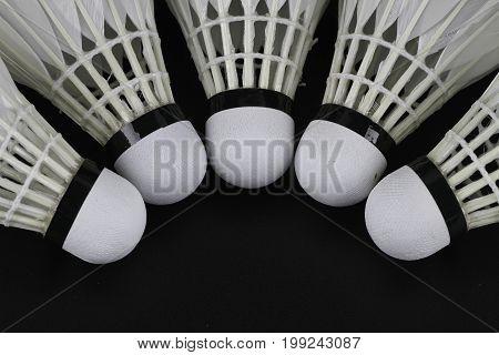 Shuttlecock On Selective Focus Over Black Background