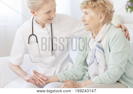 Caregiver Is Comforting An Older Lady