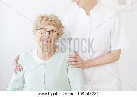 Nurse Hugs Smiling Elderly Lady