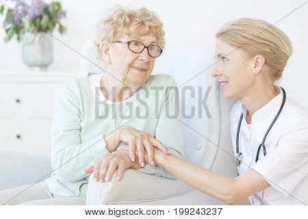Friendly Nurse Visit Old Lady