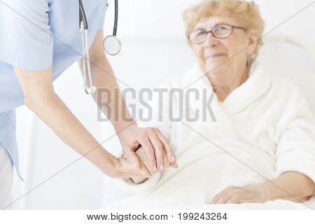 Doctor In Blue Uniform And With Stethoscope