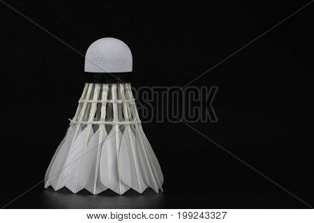 shuttlecock over black background. This is for Badminton games