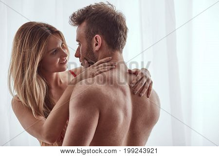 Woman Looking Into Man's Eyes