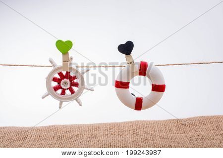 Life Preserver And Steering Wheel On A String