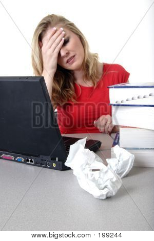 Researching Woman Holding Head