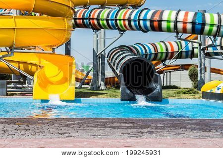 Sliders in the water park. Summer day