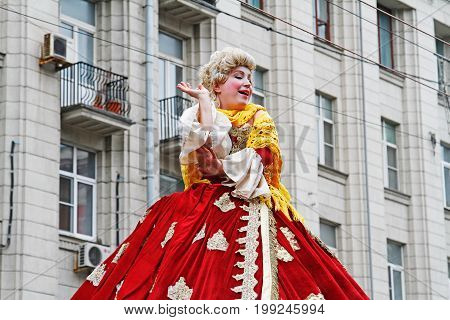 Moscow Russia - September 05 2015: Woman dressed in clothes of 18th century and in the wig on City Day on Tverskaya Street in Moscow