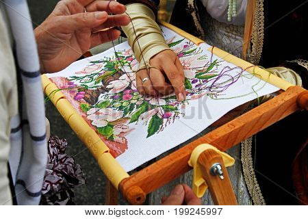 Moscow Russia - September 05 2015: Master class for embroidery on City Day on Tverskaya Street in Moscow