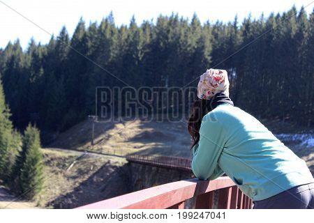 Lonely Girl On A Railway Bridge. Vorokhta, Ukraine