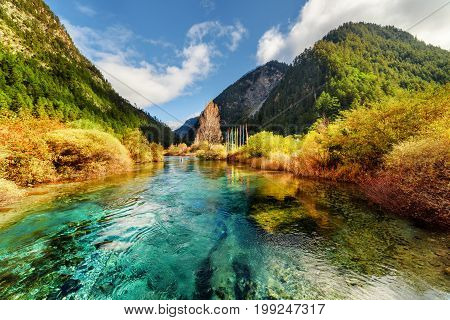 Amazing Landscape With Azure River Among Mountains