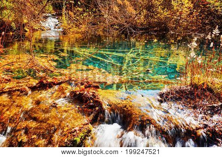 Scenic Pond With Azure Crystal Water On One Of Waterfall Levels