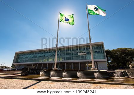 Government Building of Curitiba With Brazilian Flag Against the Sun